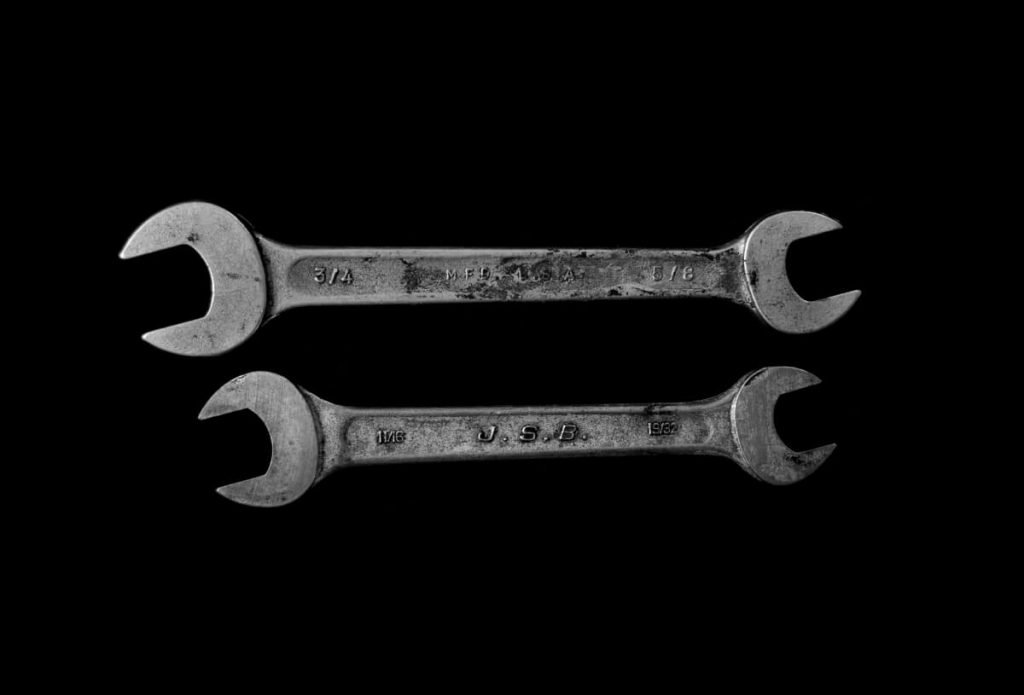 Two mechanic wrenches on a black background